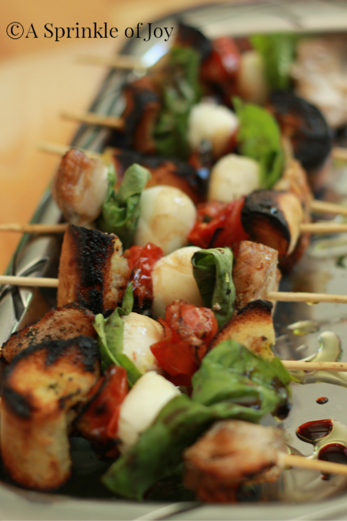 These quick and simple grilled chicken caprese kabobs are sure to be a hit at any BBQ. Grilled chicken, fresh mozzarella, basil, tomatoes and bread. All drizzled with balsamic vinegar.