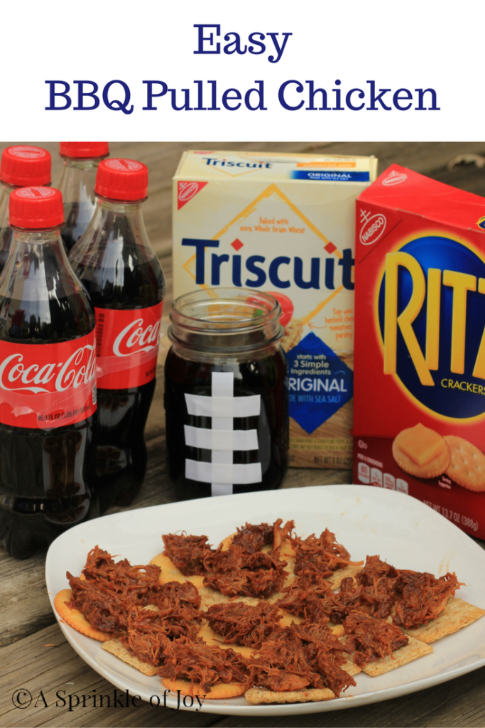 #ad Are you looking for an easy pulled chicken recipe? Chicken, BBQ sauce, come together in the crock pot to create delicious pulled chicken. #ad Are you looking for a way to change up your football parties?  Check out this yummy BBQ pulled chicken! #GameDayGreats #CollectiveBias