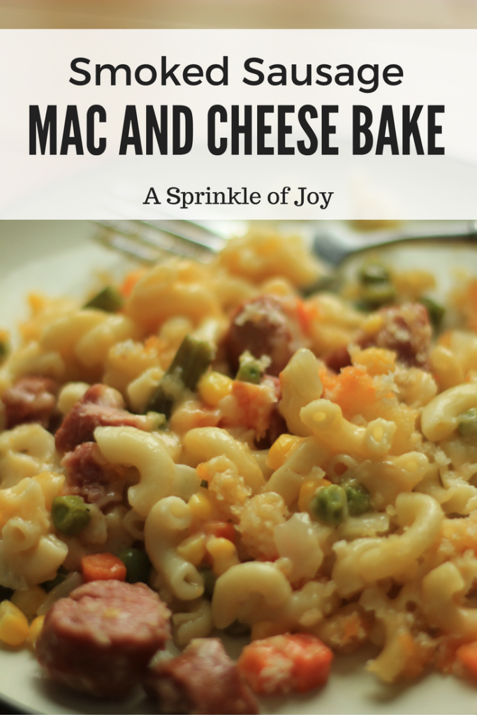 This quick and easy homemade mac and cheese is baked and made with smoked sausage and mixed veggies.