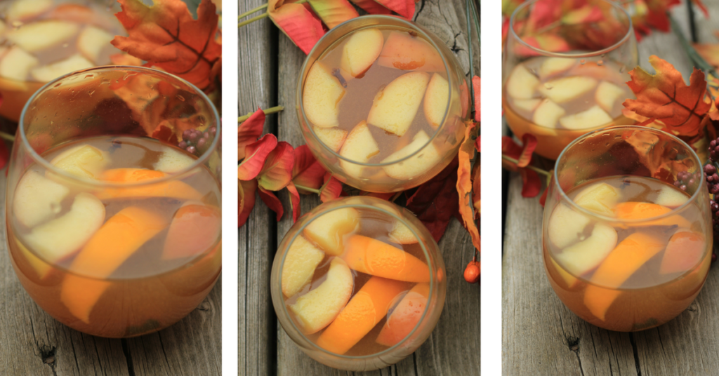 Hot mulled apple cider sangria made in the crockpot.  This recipe used white wine (moscato)  and is ready pretty quickly.