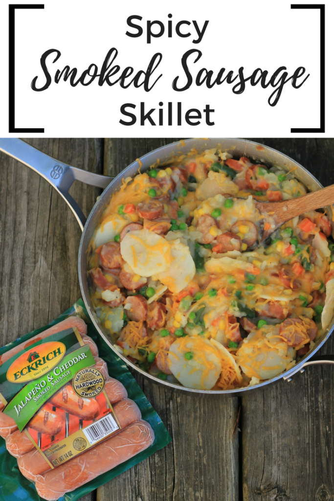 #ad This spicy smoked sausage skillet is made with potatoes, cheese, and frozen vegetable. It is a quick meal so that you can get dinner on the table fast. #EverydayEckrich